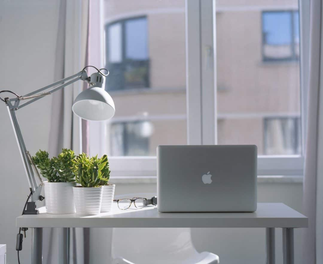 Macbook Pro on a cheap ikea desk, cheap ikea lamp and cheap ikea plants and pots